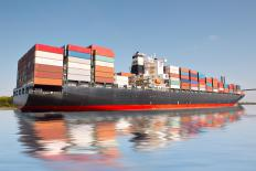 A larger container ship might be used to transport a yacht.