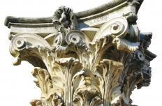 Corinthian capitals have elaborate carvings, often of leaves.