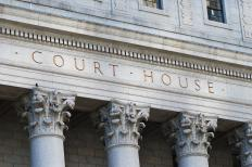 Courts provide a place for people to settle disputes.