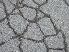 Rolled asphalt is made from different solid materials such as sand, gravel, or recycled concrete, with an asphalt binder.