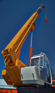 Cranes used to lift heavy loads commonly employ compound pulleys.