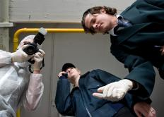 Forensic trainees might work as evidence technicians learning to collect evidence at the scene of the crime.