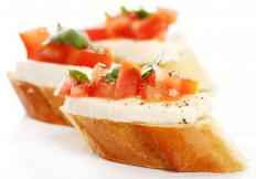 Crostini with Roma tomatoes, mozzarella cheese, and basil.
