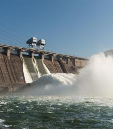 Rules of thermodynamics govern energy conversion systems, such as hydroelectric dams.