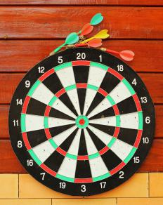 A dart board and darts.