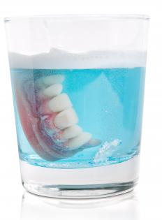 Maxiliary dentures should be placed in cleaning solution when not being used.