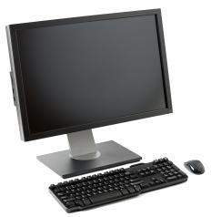 A desktop computer with an active matrix LCD TFT monitor.