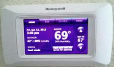 A digital furnace thermostat.