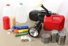 A preparedness kit with flashlights, bottled water, a radio, and other items.
