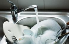 A gas bill may be lowered by limiting the amount of hot water used when washing dishes.