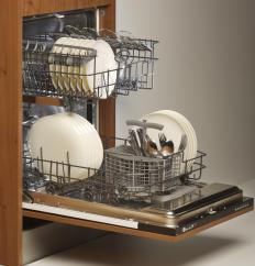 Integrated dishwashers fit into specifically designed spaces in a kitchen.