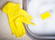 Rubber gloves should be worn when washing dishes to prevent hands from becoming dry and chapped.