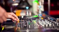 A mixing board is part of the arsenal of equipment used by DJs.