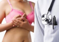 A doctor may perform a breast biopsy after finding abnormal tissue in the breats of a patient.