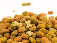 Dry dog food might do best being stored in a container on the floor under a shelf.