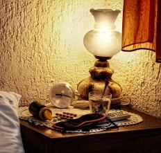 Doilies may be used to protect a furniture's finish from large items, such as heavy lamps.