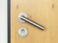 A locksmith may be responsible for installing locks on high security doors.