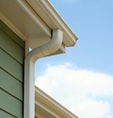 A home's downspout diverts water away from the gutter system.