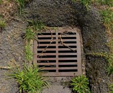 A drainage grate is a grate that covers the entrance to a ground level sewer line, which allows water to enter the sewer.