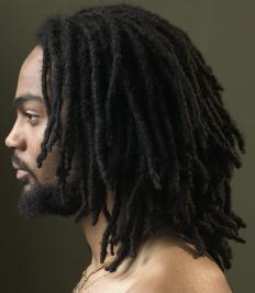 Dreadlocks are formed by tightly twisting hair into textured sections.