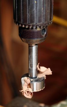 A drill with a Forstner bit.