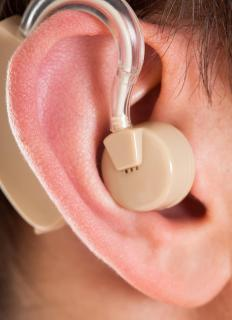 Hearing aid audiologists assist patients with improving their hearing by using a hearing device.