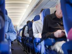 Some fliers prefer the aisle seats when riding in coach because of easier access to exit doors and overhead compartments.