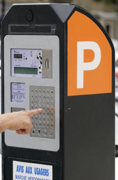 Parking attendants may be responsible for checking parking meters.