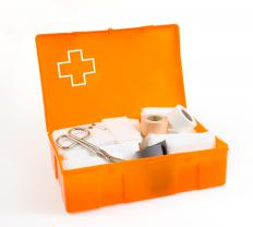 An emergency kit with bandages, scissors, gloves, and painkillers can be found in many grocery stores.