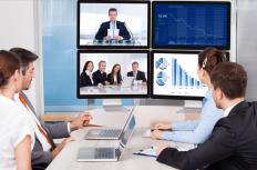 People in three different locations may communicate with each other via 3-way video conferencing.
