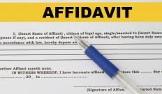 Two people sign a domestic partner affidavit to declare they are in a marriage-like relationship.