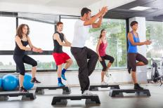Some fitness instructors hold classes at gyms for large groups of students.