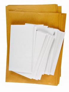 An envelope stuffer fills envelopes with advertisements, often working from home.