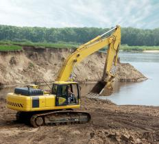 Backhoes are used for excavating rocks and dirt.