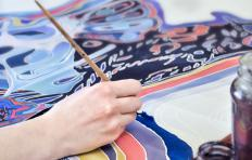 Detailed fabric painting can be done with a combination of latex paint and a textile medium.