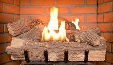 Prefab fireplaces use gas burning logs instead of wooden logs.