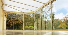 Certain varieties of conservatory blinds can allow some sunlight to pass through to light up the sunroom.