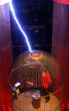 Faraday cage with bolt of electricity.