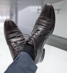 A pinstripe suit should be paired with dress shoes and dress socks.