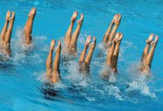 Synchronized swimmers make difficult moves look easy.