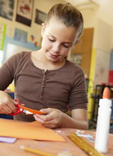 Pasting letters onto construction paper to make words may help kids learn their spelling.