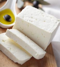 Feta is one of many indigenous cheeses used in saganaka.