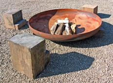 Metals that weaken under intense heat should not be used to make a home fire pit.
