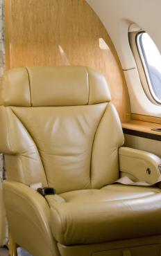 First class seats are comfortable, and commonly offer reclining options.