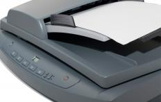 A flatbed scanner is capable of converting paper documents or photos into a digital form.