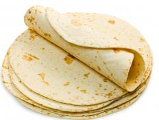 Flour tortillas are toasted for use in a tostada.