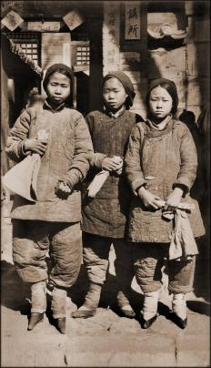 A group of girls with bound feet, a type of body modification.