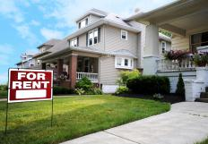 Real estate professionals negotiate the sale of property, including houses.
