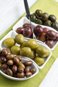 Olives in olive boats.