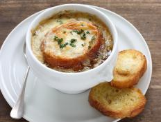 French onion soup is typically passed under a salamander broiler to melt the cheese.